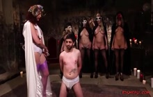Four lusty bitches playing with their slave boy