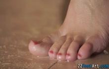 Kinky redhead gets feet jizzed